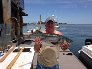 Dave Hamill displays his prize winning First Place Striped Bass in the 2015 OCYC Fishbowl Striped Bass Tournement